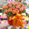 31 оранжевая роза в шляпной коробке